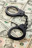 handcuffs on dollars