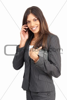 Beautiful brunette businesswoman talking on her cellphone