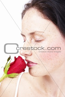 Beautiful brunette woman with a rose