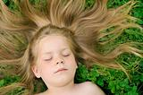 Little girl sunbathing  - laying on grass