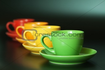 Four colored cups on a black background