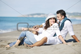 happy young couple have fun at beautiful beach