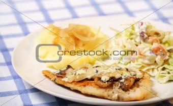 Fish with mushrooms potatoes and salad