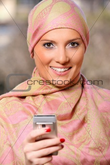 Arabic businesswoman with a cell phone