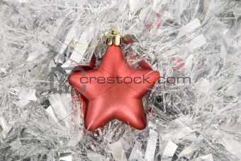 red star, christmas decoration on silver tinsel