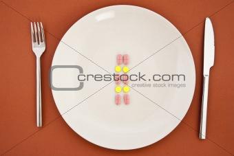 pills as dinner on plate