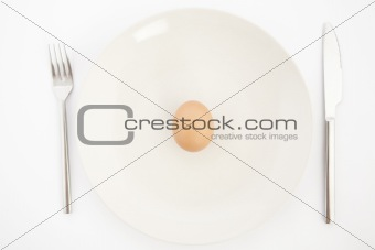 one egg on white plate