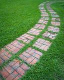 Curved path on a lawn area