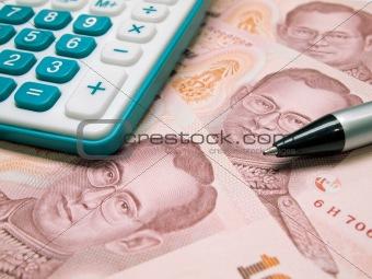 Green calculator black pen