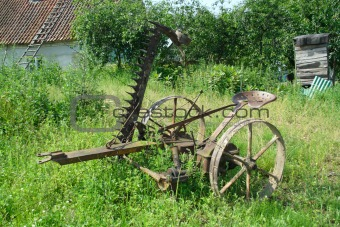 old agricultural machine - horse mower