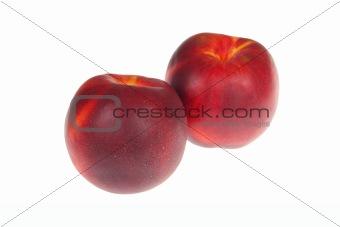 pair of ripe nectarines