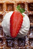 fresh waffle with cream and a strawberry