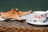 coffee cup, newspaper and starfish