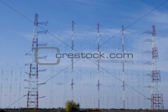 a row of electricity pylons