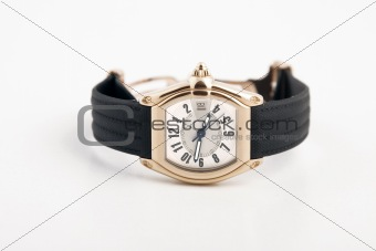 black strap and gold watch