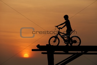 A boy sitting on bicycle
