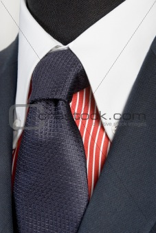 blue suit with tie and red striped shirt