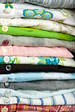 stack of colored shirt, details of buttons