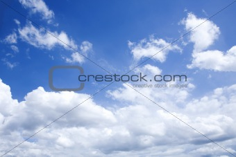 bright blue sky with white clouds on sunny day
