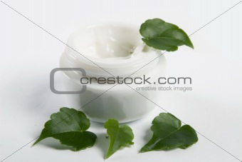 cosmetic cream with green leaves