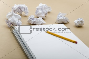 crumpled paper and yellow pencil