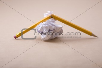 crumpled paper and crushed pencil