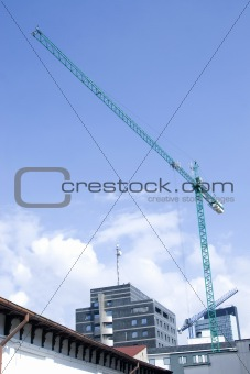 tower crane working on construction on blue sky