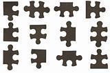 different black puzzle pieces