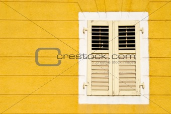 Yellow wall an and wooden window