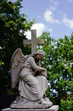 Statue of an angel with cross