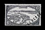 BRUNEI - CIRCA 1947 - Vintage postage stamp showing native huts of Brunei and boat people