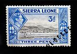 SIERRA LEONE - CIRCA 1940 - Postage stamp depicting Freetown viewed from the harbour and King George 6th inset