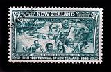NEW ZEALAND - CIRCA 1940 - Postage stamp showing maoris arriving to New Zealand in 1350 commemorating the centennial of the country