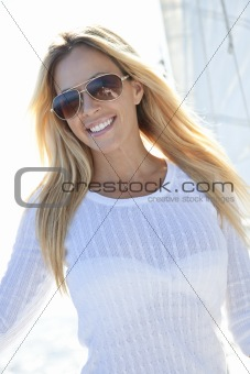 Beautiful Young Blond Woman on the Deck of a Sail Boat