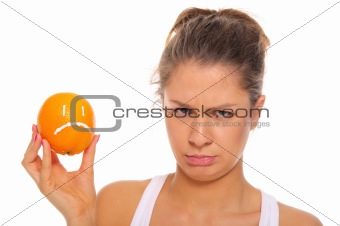 Offended woman with dissatisfied orange