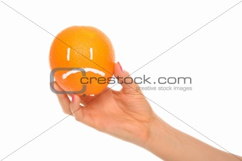 Hand holds orange with drawn insult