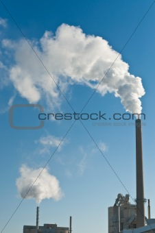 Factory with Smokestacks and Blue Sky