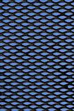 Metal grid over blue background