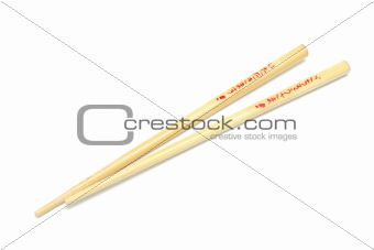 Pair of wooden chopsticks isolated on white
