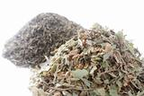 Two piles of herbs on white background
