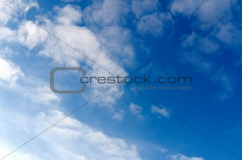 bright blue sky with white clouds.