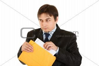 Sly modern businessman sending urgent letter