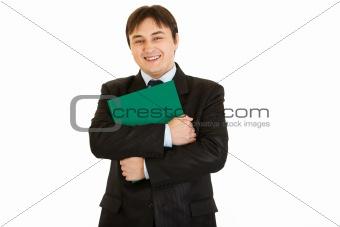 Smiling  businessman hugging  folder with documents