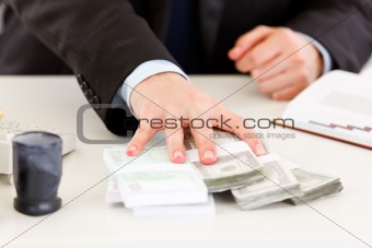 Close-up of businessman's hand  giving money packs