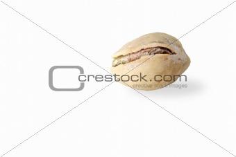Single pistachio on white background