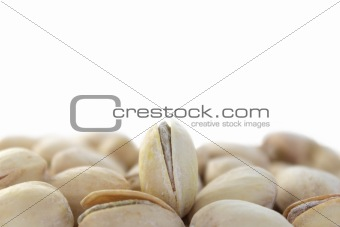 Single standing pistachio among lying ones