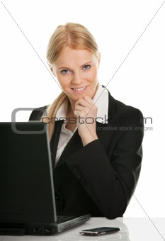 Beautiful business woman working on laptop