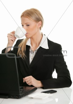 Beautiful business woman drinking coffee