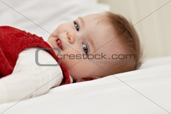 little girl lying on bed and smiling