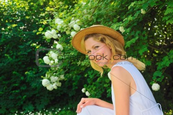 Young woman resting in garden